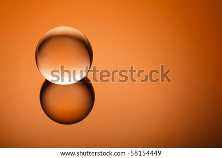 Clear crystal globe on gradient - stock photo