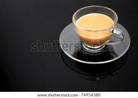 Clear cup of coffee on dark background - stock photo