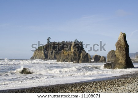 Clear day at Ruby Beach with foaming winter waves - stock photo