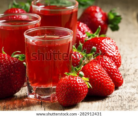 Clear fresh cold strawberry juice, selective focus - stock photo