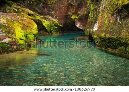 Clear Glacial Water Flowing Through Gorge - stock photo