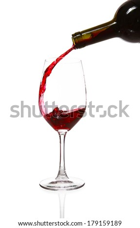 Clear glass and a bottle of red wine - stock photo