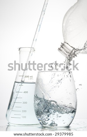 Clear glass and water - stock photo