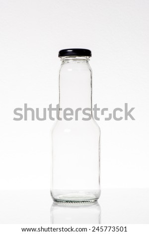 clear glass bottle isolated on white background - stock photo