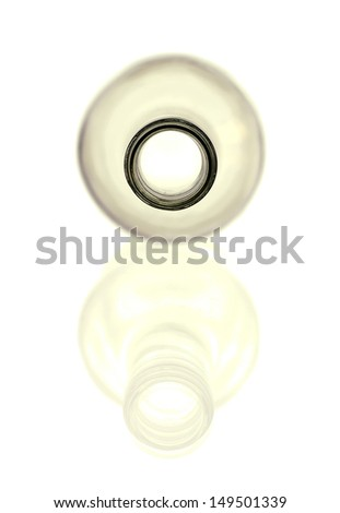 Clear glass bottle with reflection on white background with copy space. - stock photo