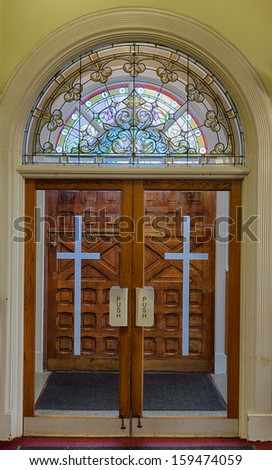 Clear glass doors inside the St. Mary of Perpetual Help Church in Chicago, Illinois