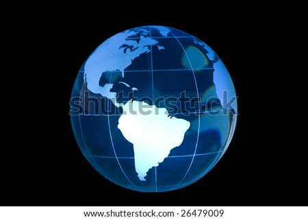 Clear glass globe lit to feature South America.  Globe against black background.
