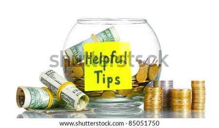 Clear glass jar for tips with money isolated on white - stock photo