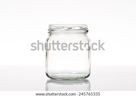 clear glass jar isolated on white background - stock photo
