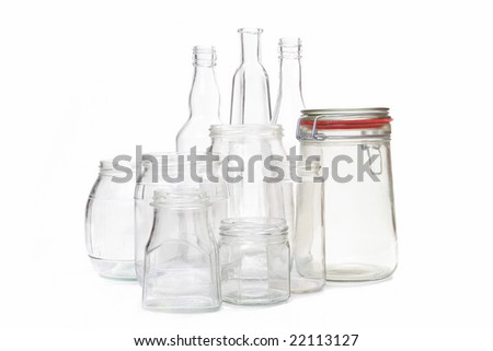 Clear glass jars and bottles over white background - stock photo