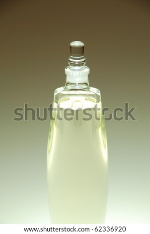 Clear glass perfume bottle isolated - stock photo