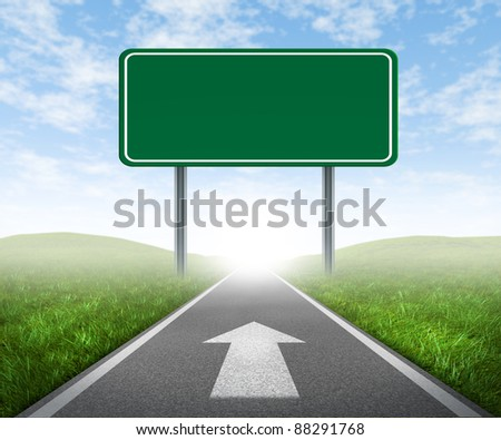 Clear goals on an open straight road highway sign with green grass and asphalt street as a concept of journey to a focused destination resulting in success and happiness with an arrow on the pavement. - stock photo