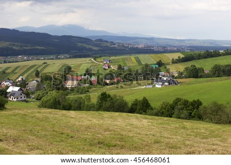 Clear green Landscape with Village Tapesovo from the summer Mountains Magura in Slovakia - stock photo