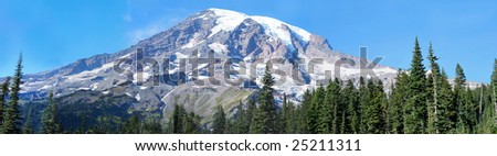 Clear panoramic view across a meadow of snow-covered Mount Rainer. This is Paradise camp. - stock photo