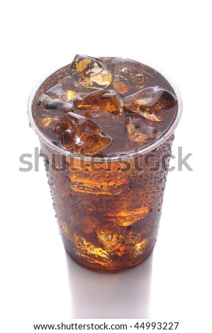 Clear Plastic Cup of Cola with Ice isolated on white with reflection vertical format high angle - stock photo