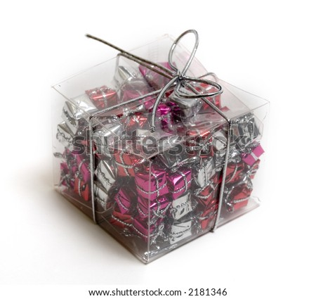 Clear plastic gift box full of little pretty colorful gift boxes. Isolated over white