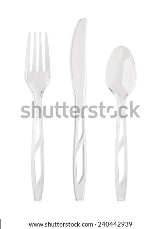 Clear Plastic Tableware. The utensils includes a fork, knife, and spoon and are isolated on white with a clipping path. - stock photo