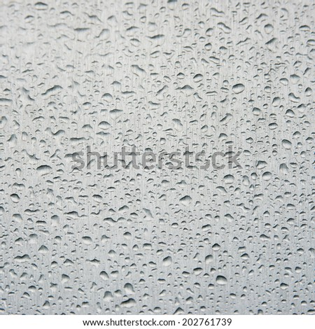 Clear raindrops on white background (ideal for unique abstract wallpapers).in square - stock photo