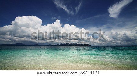 Clear sea water and blue sky with clouds - stock photo