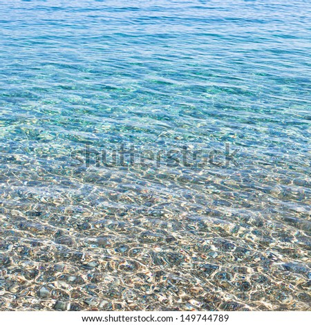 Clear sea water and pebbles as a background image - stock photo