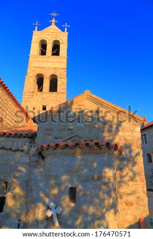 Clear sky over the stone building of orthodox monastery  - stock photo