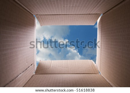 clear sky, view from inside a cardboard box - stock photo