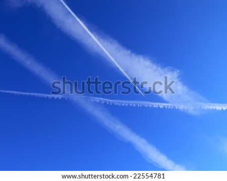 Clear sky with four airplane smacks and an airplane