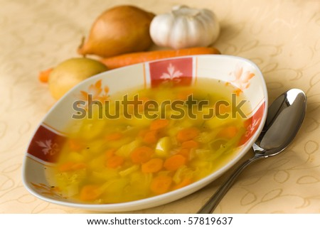 clear soup with mixed vegetable,carrot,potato,parsley,onion,