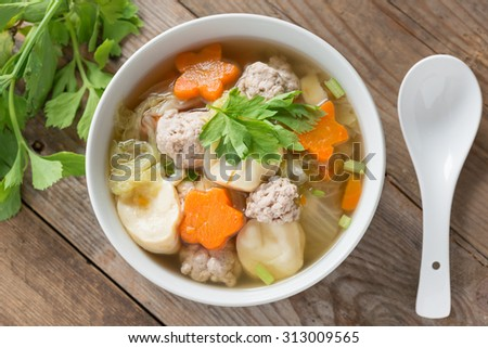 Clear Soup with Vegetables and Meatballs. Top view. - stock photo