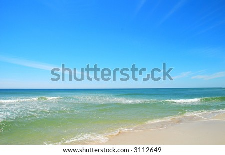 clear surf under blue sky - stock photo