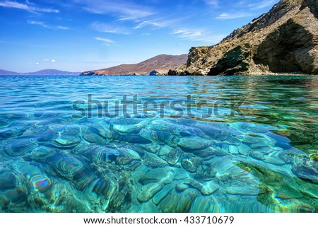Clear transparent turquoise sea waters in Gyaros island, Cyclades Greece - stock photo