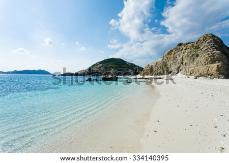 Clear tropical water and deserted coral island in atoll, Kerama Islands National Park, Okinawa, Japan - stock photo