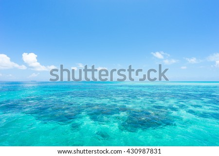 Clear turquoise water in tropical paradise with coral reef, Okinawa, Japan - stock photo