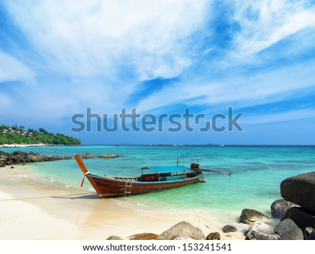 Clear water and blue sky. Beach of Phi Phi Island, Thailand. - stock photo