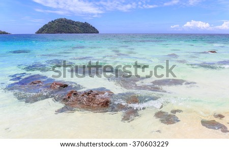 Clear water and stone in green sea at tropical island