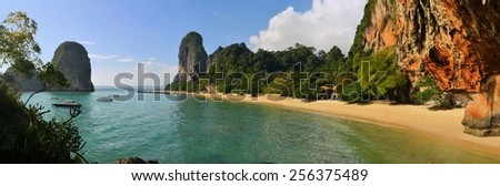 Clear water, blue sky at cave beach Phra Nang, Krabi province, Thailand. - stock photo
