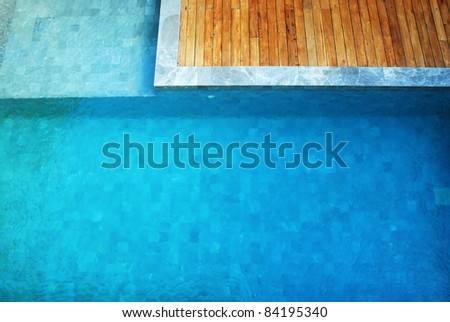 clear water in the swimming pool blue bright wood wooden - stock photo