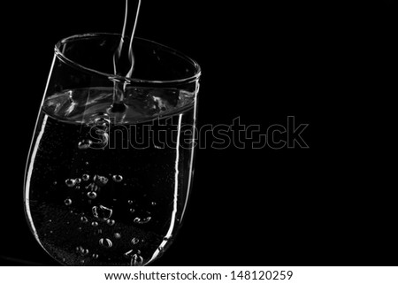 clear water splash on black background  - stock photo