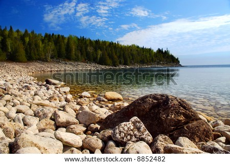 Clear waters of Georgian Bay at Bruce peninsula Ontario Canada, focus on foreground - stock photo