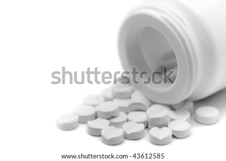 Clear White bottle and pills, isolated macro - stock photo