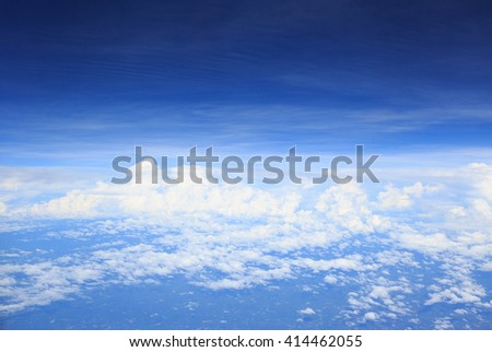 clear white cumulus cloud and cloudscape on blue sky horizon background, view from aircraft plane - stock photo