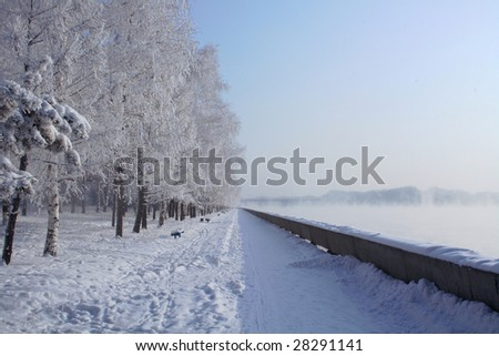 clear winter landscape at quay , river is steaming - stock photo