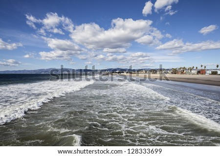 Clear winter sky and windy surf at famous Venice beach in Los Angeles, California USA. - stock photo