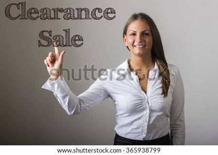 Clearance Sale - Beautiful girl touching text on transparent surface - horizontal image