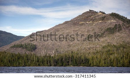 Clearcut mountain logged in the Tongass National Forest in Southeast Alaska off the Inside Passage. - stock photo
