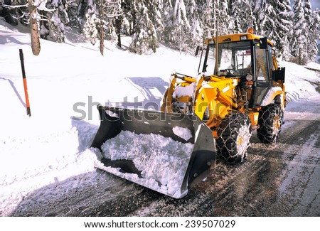 clearing roads of snow and fallen tree - stock photo