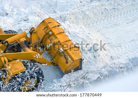 Clearing the road from snow - stock photo