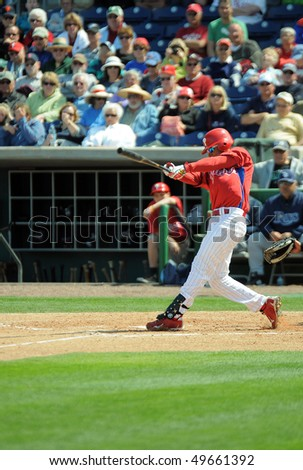 CLEARWATER, FL - MARCH 23: Philadelphia Phillies utility infielder Wilson Valdez swings at a pitch in the March 23, 2010 spring training game in Clearwater, FL - stock photo