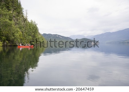 Clearwater lake with canoe, Canada - stock photo