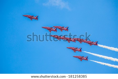 Cleethorpes, England - July 28, 2013: Royal Air Force aerobatic display team The Red Arrows fly past in formation